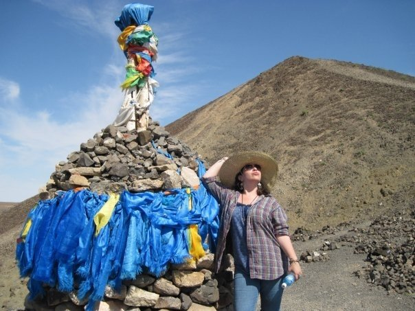 Pinchoff in Mongolia in Summer 2009, standing next to a Buddhist stupa on Wish Mountain in the Gobi desert.