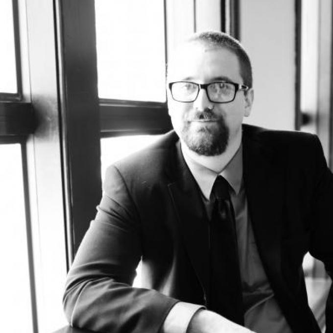 Headshot of Asher Gelzer-Govatos